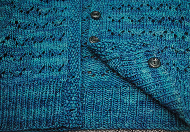 sew an extra button to the inside of your cardigan