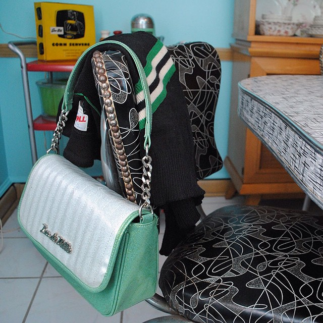 I blame prepping for today's blog post about vintage ski sweaters (link in profile) for buying this black, green & white vintage cheerleader sweater to match my @luxdevillehandbags purse from their latest sale. That's my story and I'm sticking to it. ? (preview of the new kitchen color behind it!)