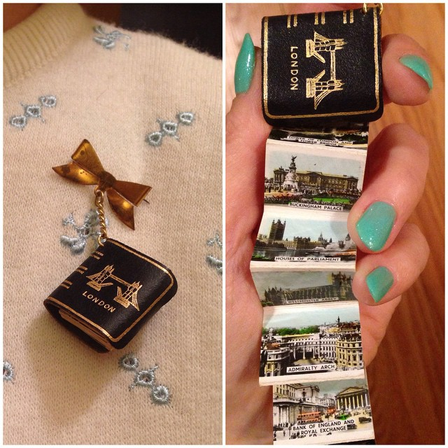 In love with the London brooch Mel gave me for Christmas. It folds out to show miniature colorized photos of places like Buckingham Palace, Westminster Abbey, and the Tower of London. I looove souvenir pieces! ? #noveltybroochfriday