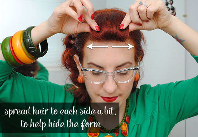 spread hair on roll to hide the form